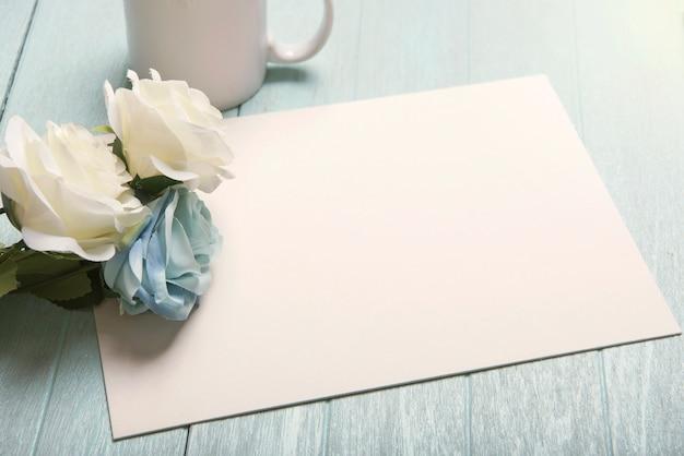 Mockup wedding paper card and rose flower.