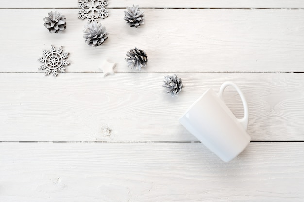 Mockup white mug on a wooden background, in christmas decorations. flat lay