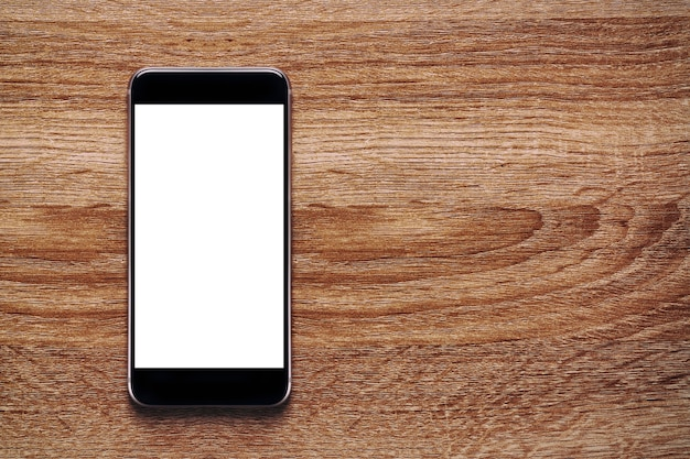 Макет мобильного телефона с белым экраном на старом классическом деревянном полу