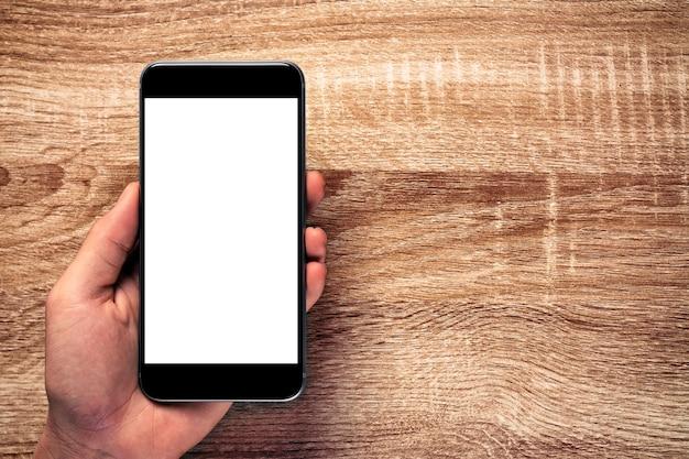 오래 된 나무 테이블에 모형 흰색 화면 휴대 전화
