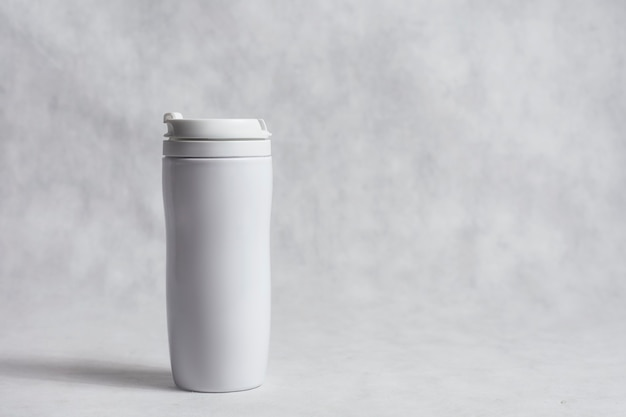 Mockup of a white thermo mug for cold and hot drinks