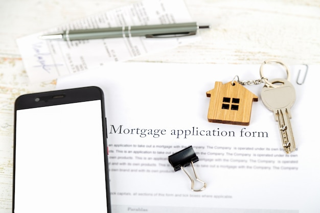 Mockup with smartphone screen and approved mortgage loan agreement application