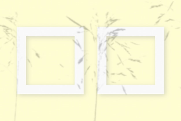 Mockup with vegetable shadows superimposed on 2 square frames of textured white paper on a yellow table background.