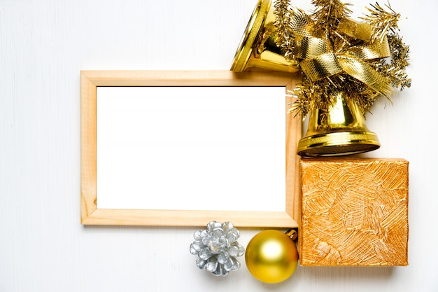 Mockup of wooden frame with christmas decorations, ball, bells and present