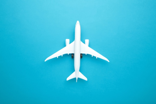 Model airplane on blue pastel color background. travel concept