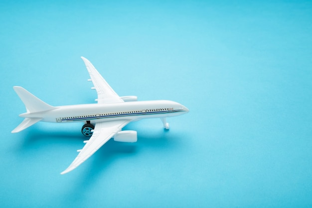 Model airplane on blue pastel color.