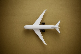 Model airplane on old paper background.