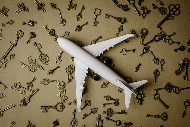 Model airplane and pile of key - for success and business background