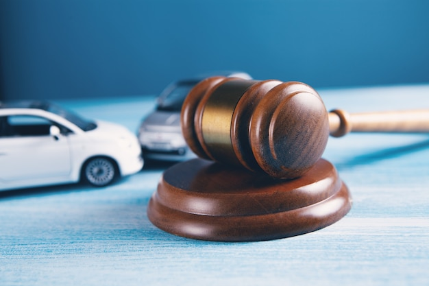 Model of car and gavel accident lawsuit or insurance