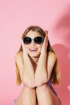Model concept with happy girl wearing sunglasses