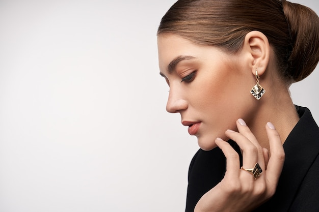 Model demonstrating earrings and ring