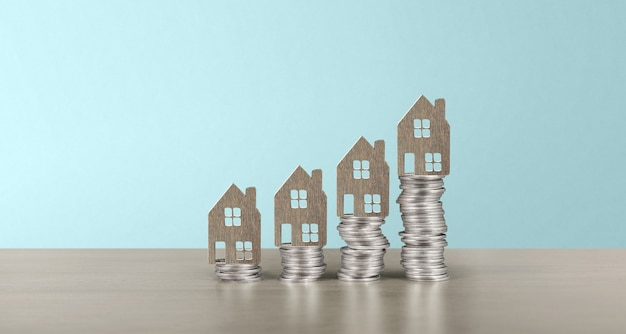 Model of detached miniature house mock up on coins. property real estate investment concept