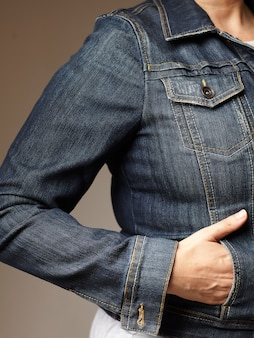 Model details wearing blue denim jacket