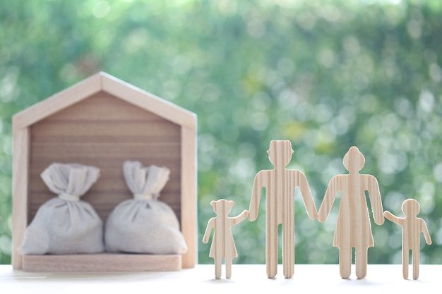 Model family and model house on natural green background