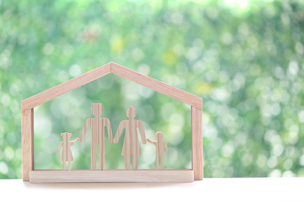 Model family in model house on natural green backgroundnew home and real estate concept