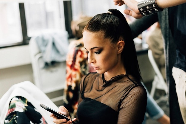 Model getting her hair done