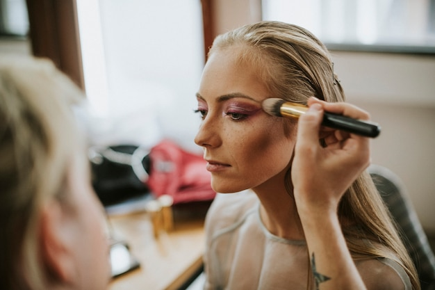 Model getting her makeup done