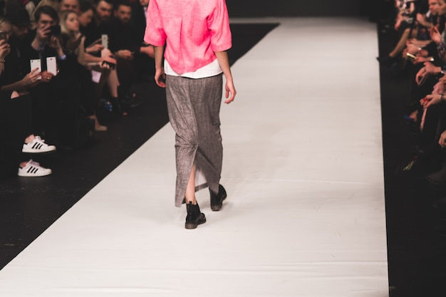 The model goes along the catwalk.