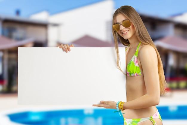 Model holding blank sign