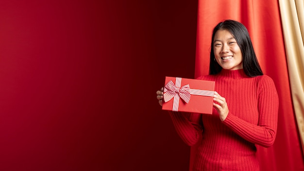 Model holding gift box for chinese new year with copy space