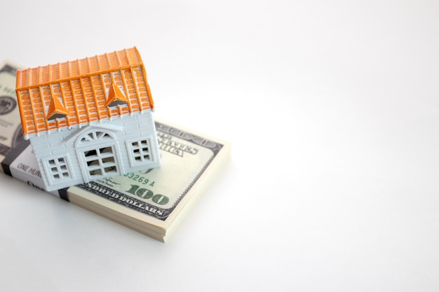 Model house is placed on the us dollar banknotes