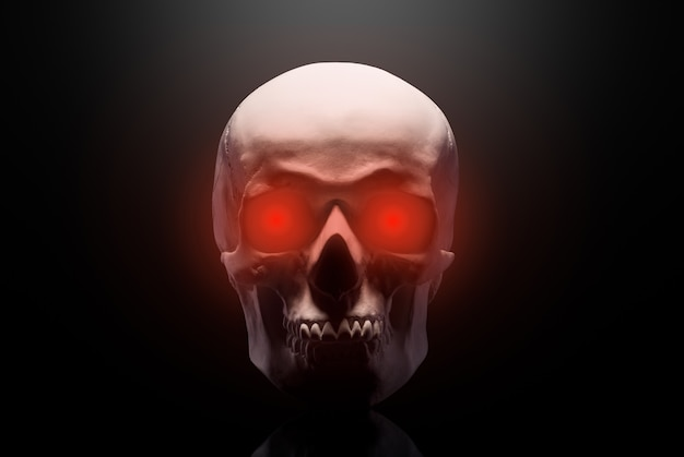 Model of the human skull with red eyes isolated on black background