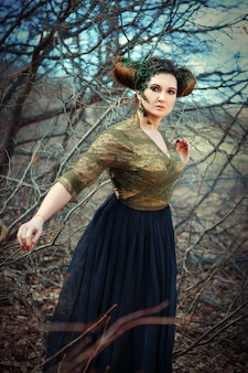 Model is posing in a spring forest as a faun