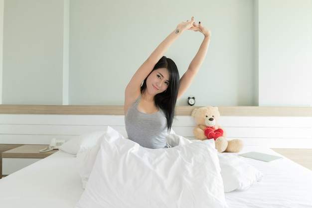 Model lazy arm stretched in the morning bedroom