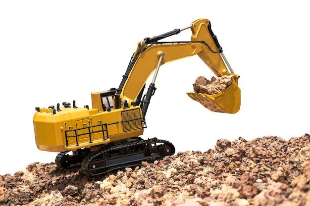 クリッピングパスで白で隔離された地面の掘削機のバックホーのモデル