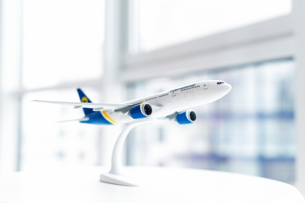 Model of a passenger plane close-up on the table. air travel concept