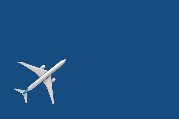 Model plane, airliner, airplane on blue background. travel and transportation concept