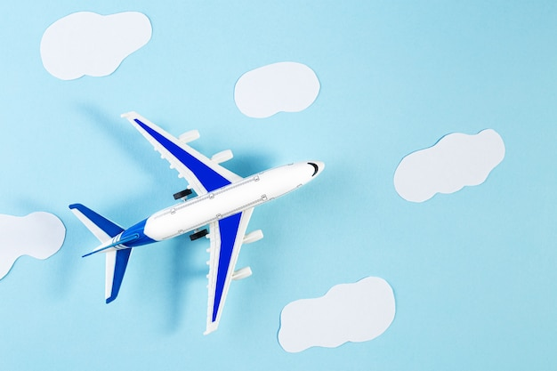 Model plane, airplane on blue pastel color background. summer travel or vacation concept. Premium Photo