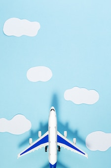 Model plane, airplane on blue pastel color background. summer travel or vacation concept