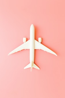 Model plane, airplane on pink pastel color background with copy space.flat lay design.