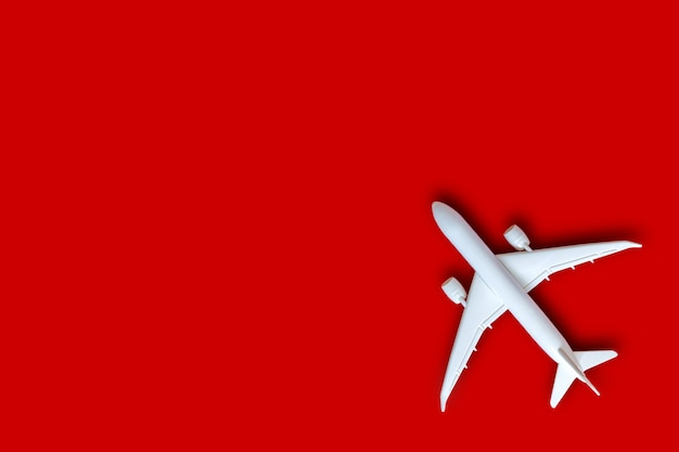 Model plane, airplane on red color background with copy space