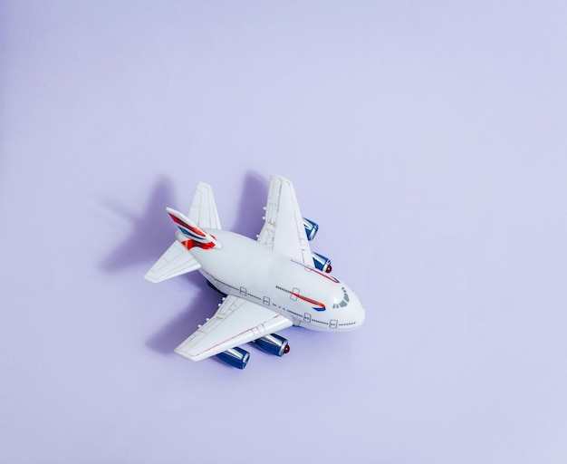 Model plane,airplane on violet color space