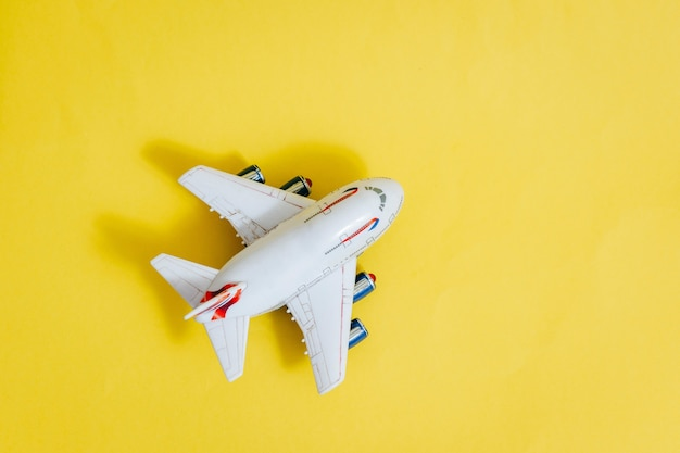 Model plane,airplane on yellow color space
