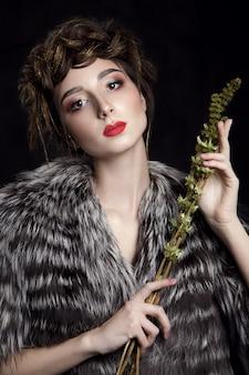 Model posing in black fur coat