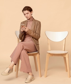 Model sitting next to an empty chair