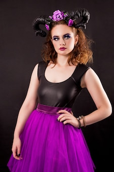 A model in a skirt-tutu with horns.