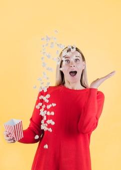 Model slipping bag of popcorn