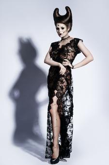 Model in spooky image of a broken doll