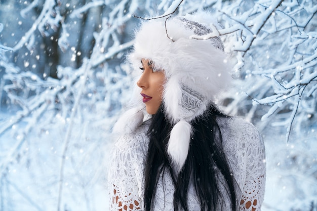 Model in stylish warm hat for winter walk.
