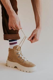 Model tying shoelaces suede sneaker