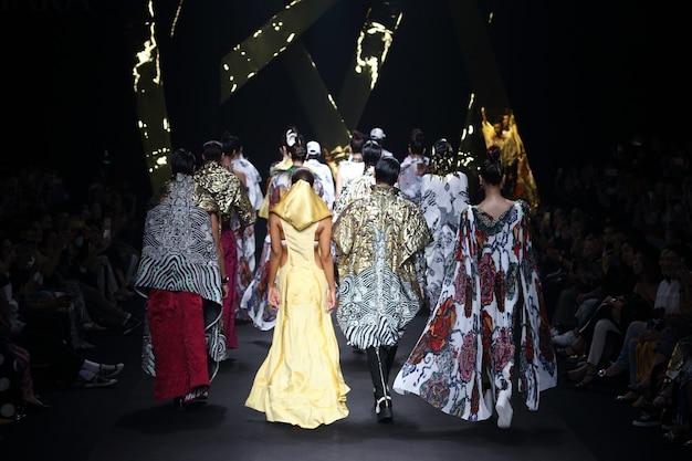 Model walk back on mirror on fashion show