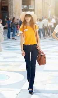 Model walks in the umberto primo gallery in naples.