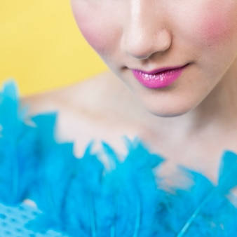 Model wearing feathers close up