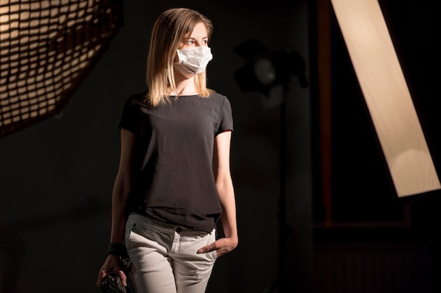 Model wearing medical mask in a studio
