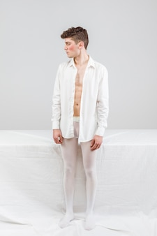 Model in white standing and looking away