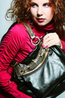 Model with bag. posing in the studio